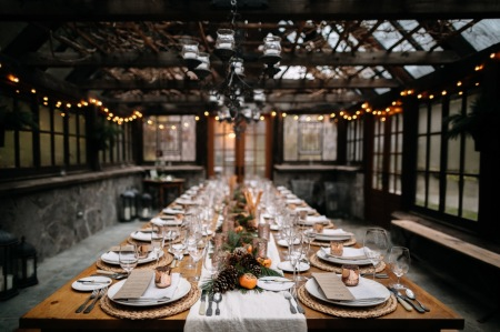 Set tables for fancy dinner in a green house